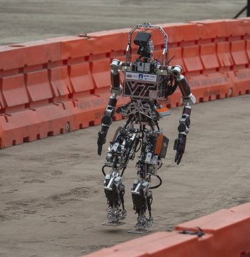 Rescue robot sent into rubble following a devastating earthquake to shut off critical valves — too dangerous a task for humans.